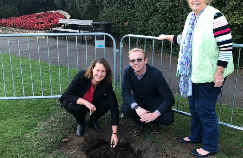 Victoria Prentis MP planting one of the trees at Garth Park with Councillors Jason Slaymaker and Lynn Pratt