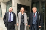 of Victoria Prentis MP outside the Ministry of justice with James Macnamara (left) and George Green (right)